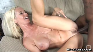 Gorgeous mom tasting on black cock