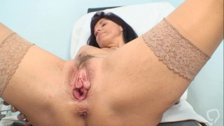 Mature Livie in full gyno exam scene