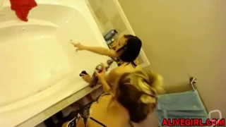 Emma with a girlfriend in sexy housemaid's outfits makes funny cleaning