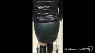 Shopping in leather miniskirt, shiny jacket and high boots