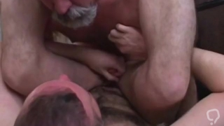 Bottom takes daddy spit while being fucked.