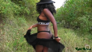 Ebony girl strips down in a forest and shows her goods