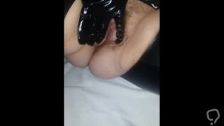 Playing with hariy pussy in latex catsuit