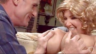 Husband And Wife Making Love On Sofa