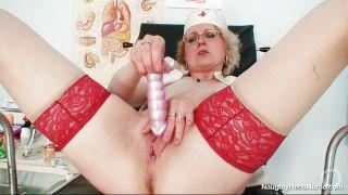 Sexy Blonde Nurse Masturbating With A Dildo At Workplace