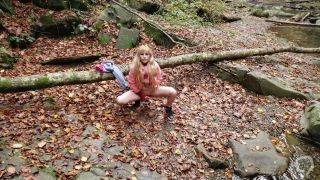 Sexy blonde teen doing pee in forest ( 4k)