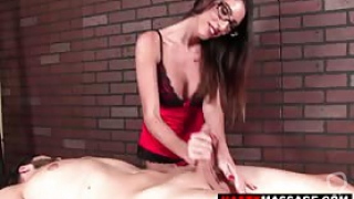 Nasty masseuse gives a guy a handjob but then squeezes his cock to make a jizz volcano