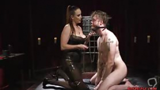 Super hot mistress with big tits and ass enjoys fucking this dude in his ass with a strap on