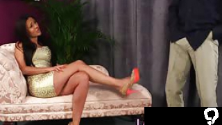 Glamorous domina in high heels watches naked loser tug his cock