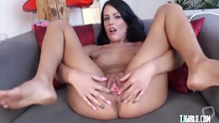Sexy petite babe stretches her pussy really wide by using a stretching tool