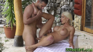 Blonde babe gives footjob