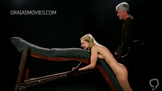 Little blonde whore caned while chained down