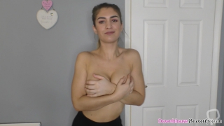 Cute brunette showing downblouse and tits while dancing