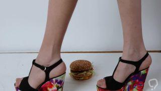 Trampling burger on styrofoam in wedges