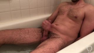 Stud with nice cock blows load in bathtub