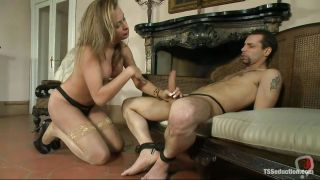Stylish T-girl Giving Head To Tied Guy