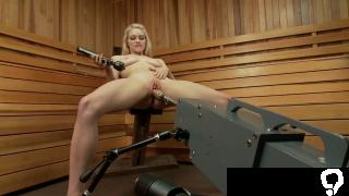 Blonde fucks machine in sauna