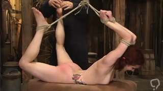 Flexible slut is inverted suspended and made to orgasm