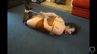 Plump girl tied on the floor