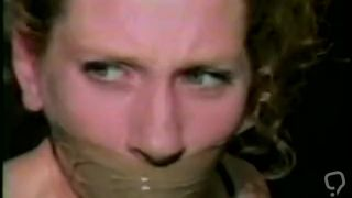 Girl gagged with packing tape