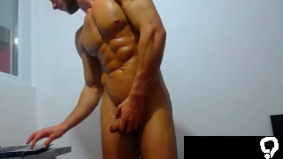 Bodybuilder With A Vibrator Up The Ass