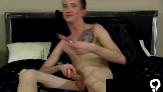 Charming young man interviewed before dildoing his ass