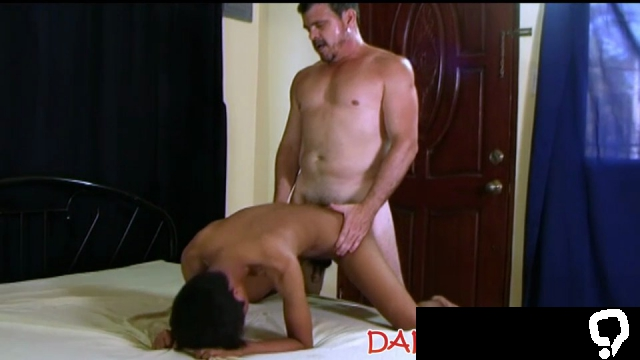 Dominant daddy ropes young Asian down for anal and facial