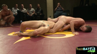 Naked studs wrestling on the floor