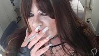 Smoking tranny in dark lipstick