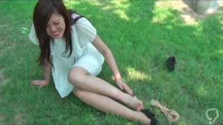 Chinese girl puts on tan nylon over the bandage for her sprained ankle